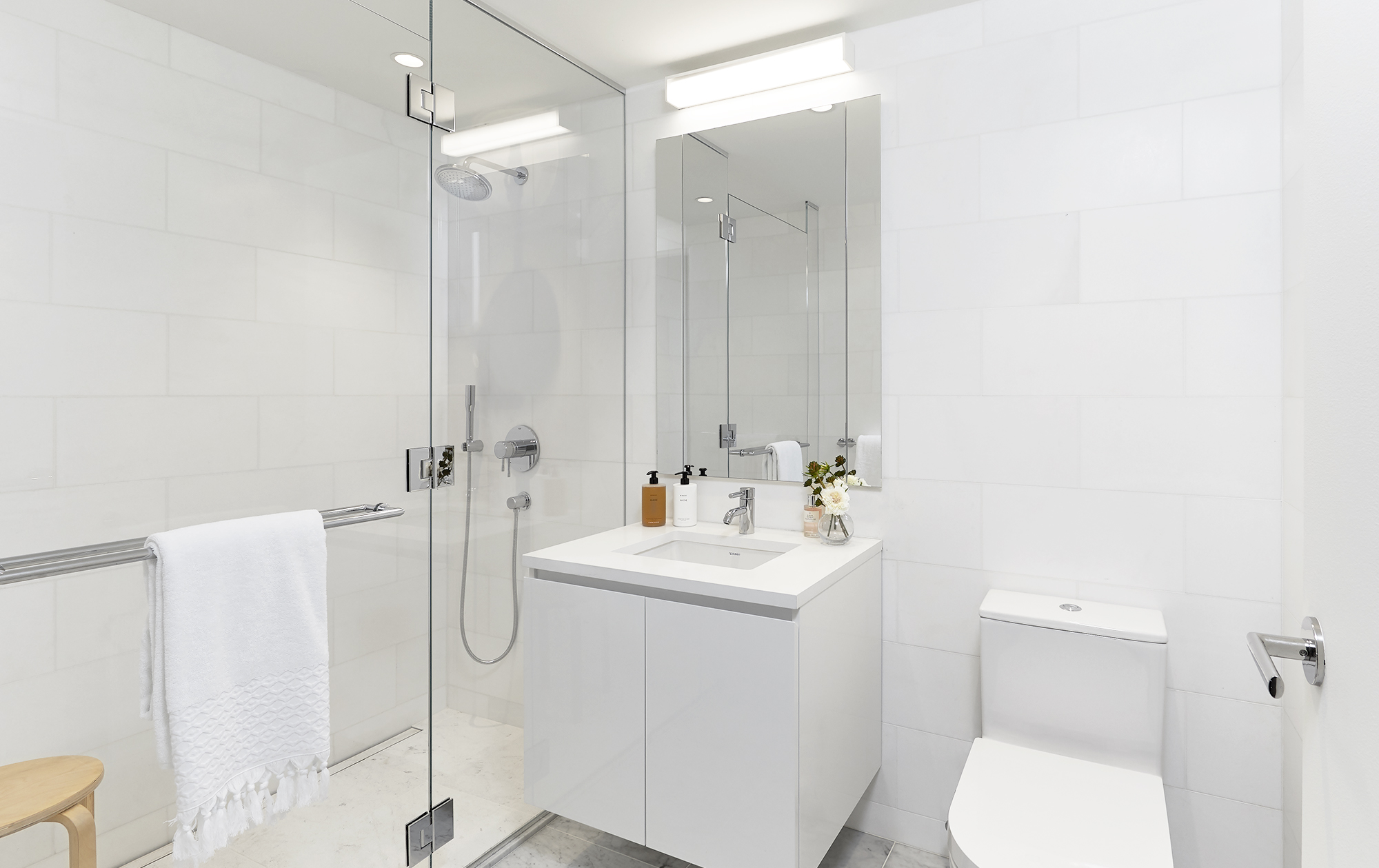Carrara marble stone floors throughout the bathrooms