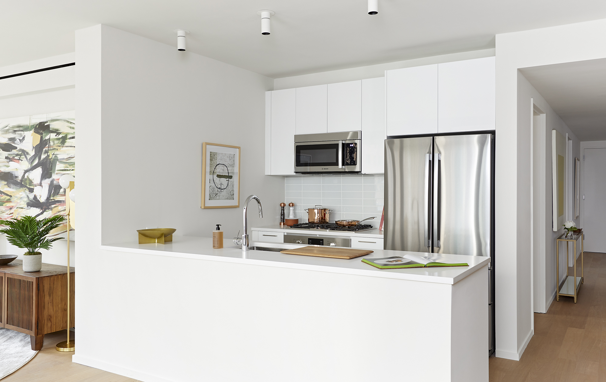 Kitchen featuring white lacquer custom Italian cabinetry
